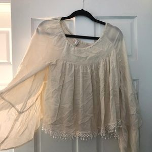 Cream bell sleeved top with embroidered hem